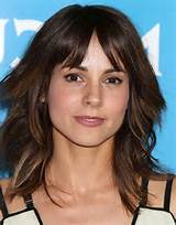 ... Haircut: Latest Medium Layered Hairstyle with Wispy Bangs /Getty