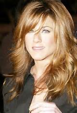 Medium layered hairstyles with side swept bangs pictures 4