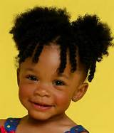 Two strand twist in the bang with two ponytails so cute!