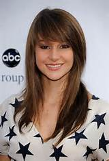 full side-swept bang is romantic and soft for a square face.