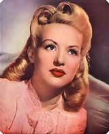 classic late 40s hairstyle with victory rolls! | source