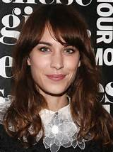 ... Chung Medium Hairstyles: Curled with Side-swept Bangs /Getty Images