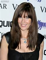 Carol Alt - Long textured hairstyle with below the eyebrows bangs