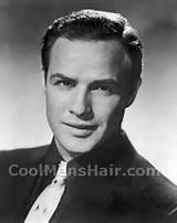 Photo of Marlon Brando short classic hairstyle for men.