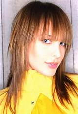 ... side fringes medium length angled bob haircut with side swept bangs