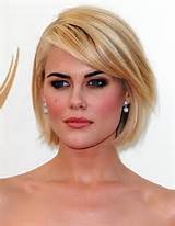 Blonde Bob Hairstyles with Side Swept Bangs / Via
