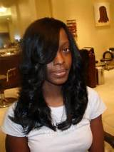 feathered curled long black weave hairstyles