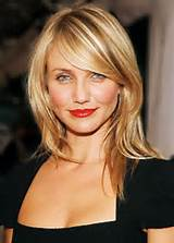 medium layered hairstyles with side swept bangs