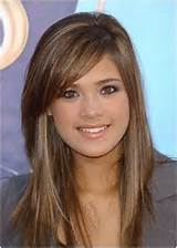 Long Layered Hairstyle With Side Swept Bangs/Pinterest