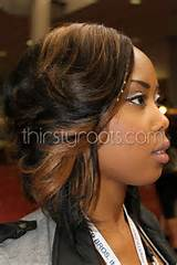 this is a really nice picture of a black girl with weave in her hair ...