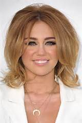 ... her edgy pixie, Miley Cyrus has a stylish bob styled with a bouffant