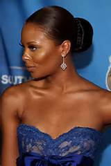 ... host and fashion model Eva Marcille is seen in a sock bun hairstyle
