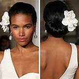 image of black seductress is well reflected in this high bun hairstyle ...