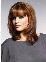 medium layered hairstyles with bangs / Source